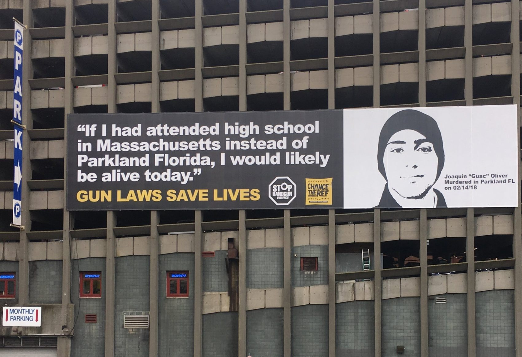 Parents of Parkland shooting victim Joaquin Oliver joined state and federal officials for the unveiling of a billboard over the Massachusetts Turnpike in the Back Bay, calling for other states to replicate Bay State gun laws. (Katie Lannan/SHNS)