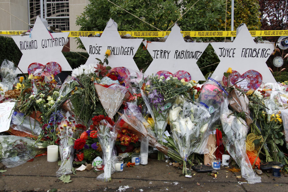 These are flowers and Stars of David on Thursday, Nov. 1, 2018, at a makeshift memorial outside the Tree of Life Synagogue to the 11 people killed Oct. 27, 2018 while worshiping in the Squirrel Hill neighborhood of Pittsburgh. (Gene J. Puskar/AP)