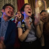 Supporters of the 'Yes on 3' campaign celebrate victory when it is announced Massachusetts voters decided to uphold a law offering transgender people protections in public accommodations. (Jesse Costa/WBUR)