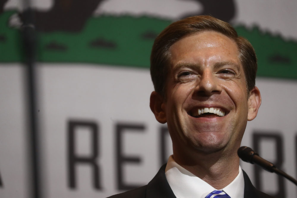 Democratic congressional candidate Mike Levin smiles at a 2018 midterm elections rally on Oct. 4, 2018 in Fullerton, Calif. (Mario Tama/Getty Images)