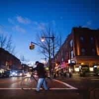 People walk on a local street past restaurants in Astoria in the Queens borough of New York. (Eduardo Munoz Alvarez/AFP/Getty Images)