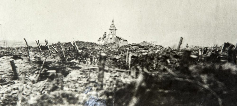 German shells falling on a church, Rambucourt, France. April 20, 1918. (Massachusetts National Guard Archives)