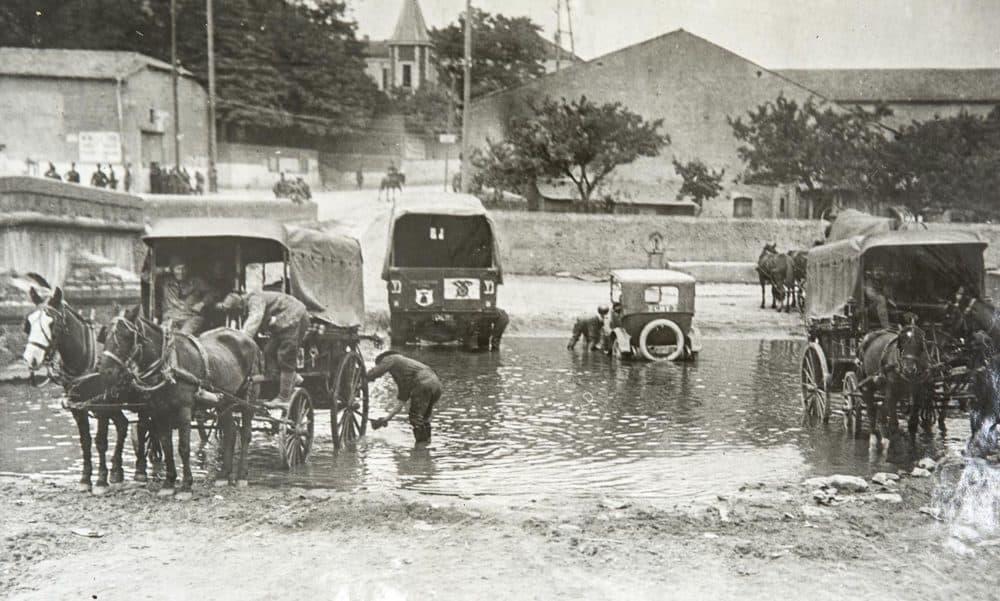 Members of the 104th Ambulance Company washing vehicles. July, 1918. (Massachusetts National Guard Archives)