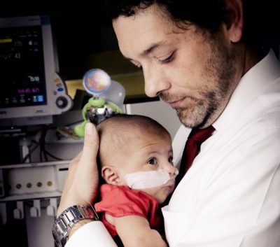 Jason Rosenberger holds his daughter, Aubree Lynn Rosenberger. (Courtesy of Kristy Williams, Dimples Photography Atlanta)
