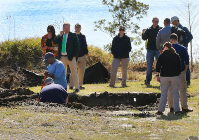 The FBI, investigators and excavation personnel at the scene of a lot in Orlando where an excavator dug up a section of the yard in hopes of finding the stolen Gardner Museum artwork. (John Tlumacki/Boston Globe)