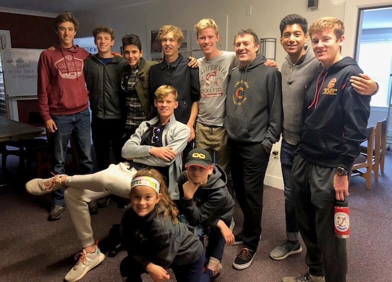 Paradise High School senior and cross-country runner Gabe Price (fourth from left) is joined by Charlie Giannini (left) and other members of the Chico High School varsity cross-country team at KHSU public radio in Arcata, Calif. (Courtesy of Gabe Price)