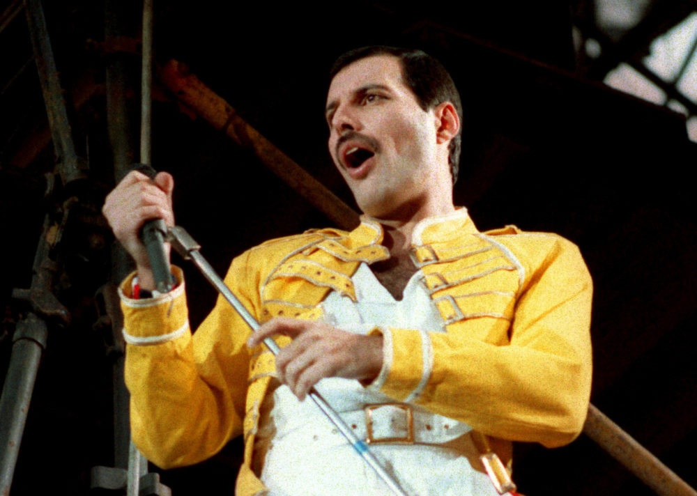 "Queen lead singer Freddie Mercury performs in Germany on July 20, 1986, about a decade after ""Bohemian Rhapsody"" was released. (Marco Arndt/AP)"