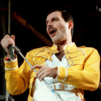 """Queen lead singer Freddie Mercury performs in Germany on July 20, 1986, about a decade after """"Bohemian Rhapsody"""" was released. (Marco Arndt/AP)"""