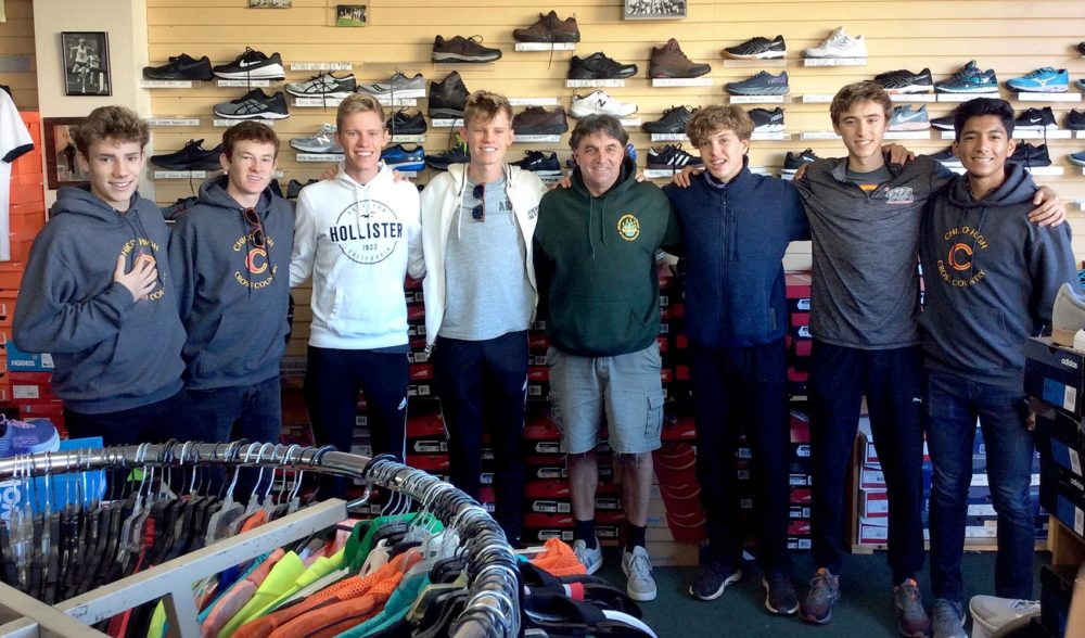 Paradise High School senior and cross-country runner Gabe Price (third from right) is joined by members of the Chico High School varsity cross-country team, with Mike Williams, owner of the The Jogg'n Shoppe in Arcata, Calif. The Chico runners are training with Price on the Redwood Coast ahead of the state cross-country championships in Fresno next weekend. Williams donated running gear to Price after he and his family lost their home in the Camp Fire. (Courtesy of Christine Callahan)