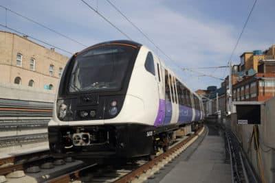 An Elizabeth Line test train passes through Custom House station in April 2018. (Courtesy of Crossrail)
