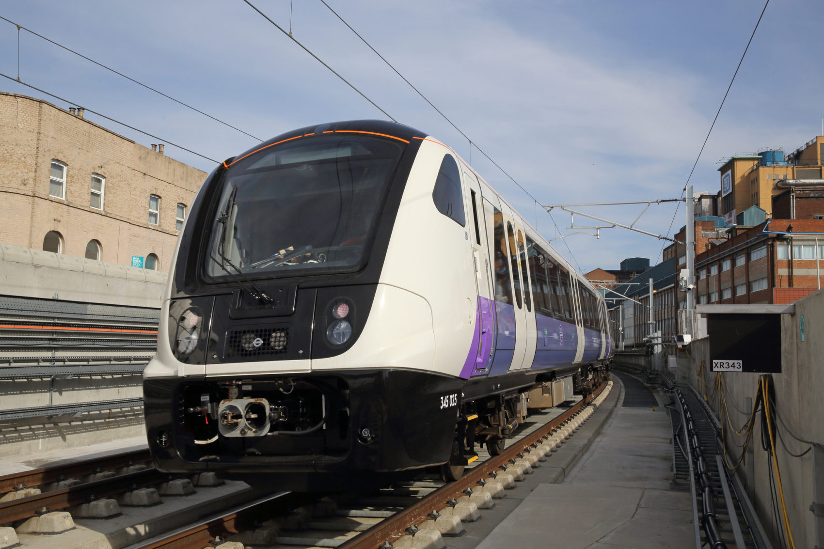 An Elizabeth Line test train passes through Custom House station in April 2018. (Courtesy of Crossrail)