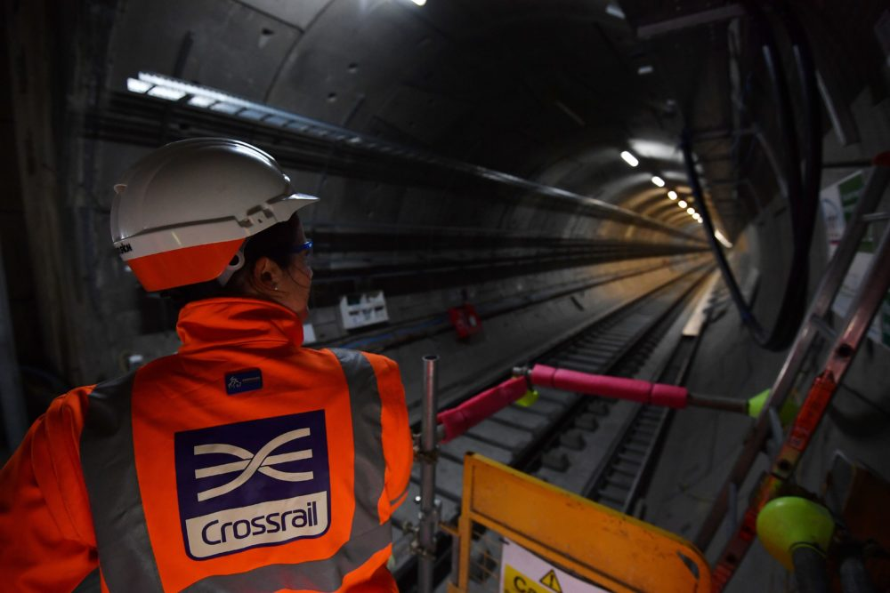 A worker looks along a train tunnel at the Canary Wharf Crossrail station in London on Feb. 8, 2017. (Ben Stansall/AFP/Getty Images)