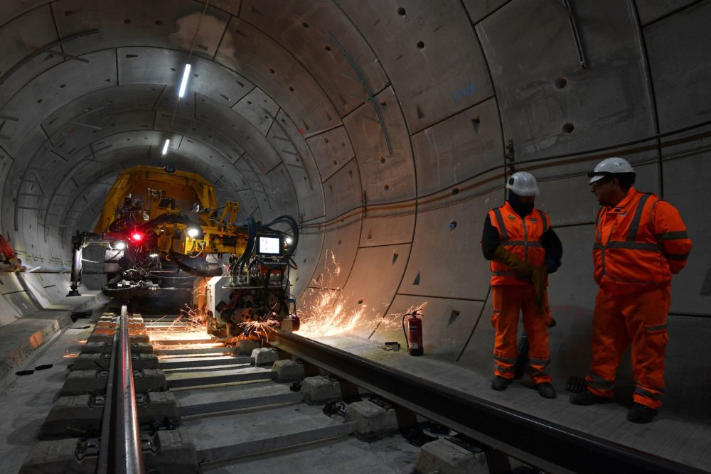A machine welds a section of track inside a Crossrail tunnel, beneath Stepney in east London, on Nov. 16, 2016. (Ben Stansall/AFP/Getty Images)