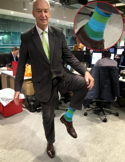 Jon Snow shows off one of his many colorful pairs of socks. (Jeremy Hobson/Here & Now)