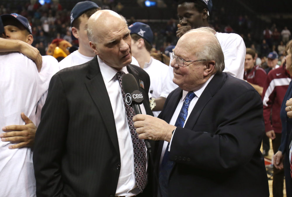 NEW YORK, NY - MARCH 16:  Head coach Phil Martelli of the Saint Joseph's Hawks is interviewed by Verne Lundquist of CBS after defeating the Virginia Commonwealth Rams during the Championship game of the 2014 Atlantic 10 Men's Basketball Tournament at Barclays Center on March 16, 2014 in the Brooklyn borough of New York City. The Hawks beat the Rams 65-61.  (Photo by Mike Lawrie/Getty Images)
