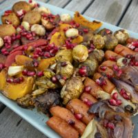 Roast vegetables with a pomegranate vinaigrette and pomegranate seeds, from chef Kathy Gunst. (Robin Lubbock/WBUR)