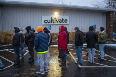 A line forms outside of Cultivate in Leicester, one of two stores to legally sell marijuana recreationally in Massachusetts, on Tuesday. (Jesse Costa/WBUR)