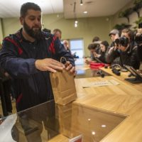 Veteran Stephen Mandile make the first purchase of recreational marijuana in Massachusetts at Cultivate in Leicester. (Jesse Costa/WBUR)