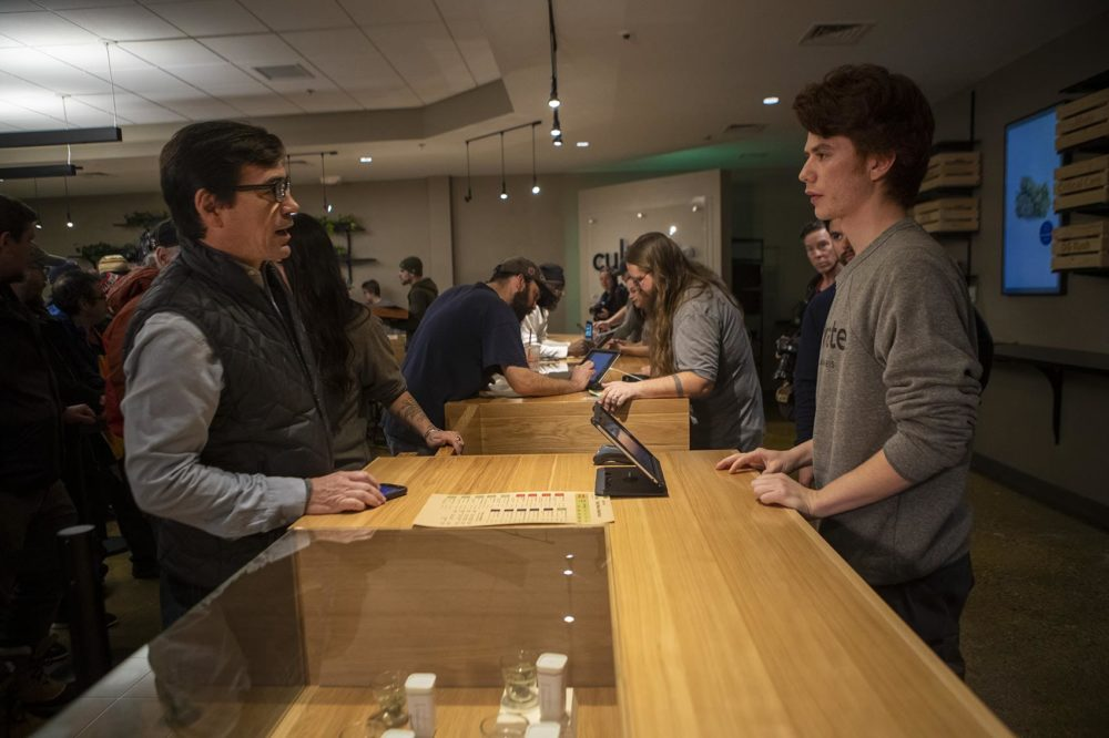 In Leicester, Cultivate workers help customers at the counter during the first day of recreational marijuana sales in Massachusetts. (Jesse Costa/WBUR)