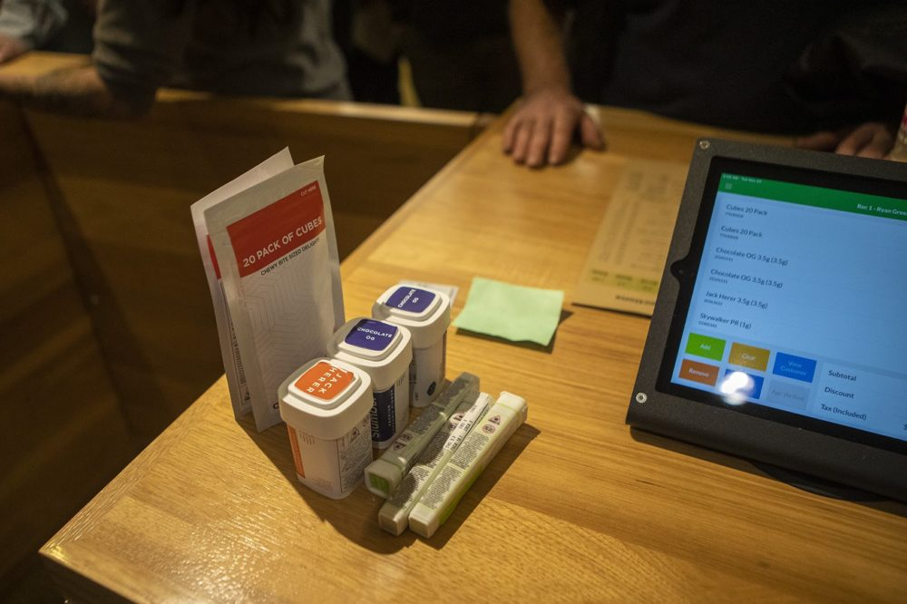Some marijuana products sit on the counter as they are rung up for sale at Cultivate. (Jesse Costa/WBUR)