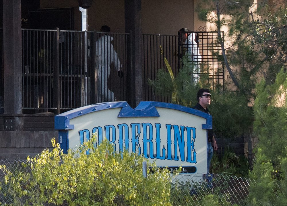 Investigators work at the scene of a mass shooting at the Borderline Bar & Grill in Thousand Oaks, Calif., on Nov. 8, 2018. (Robyn Beck/AFP/Getty Images)