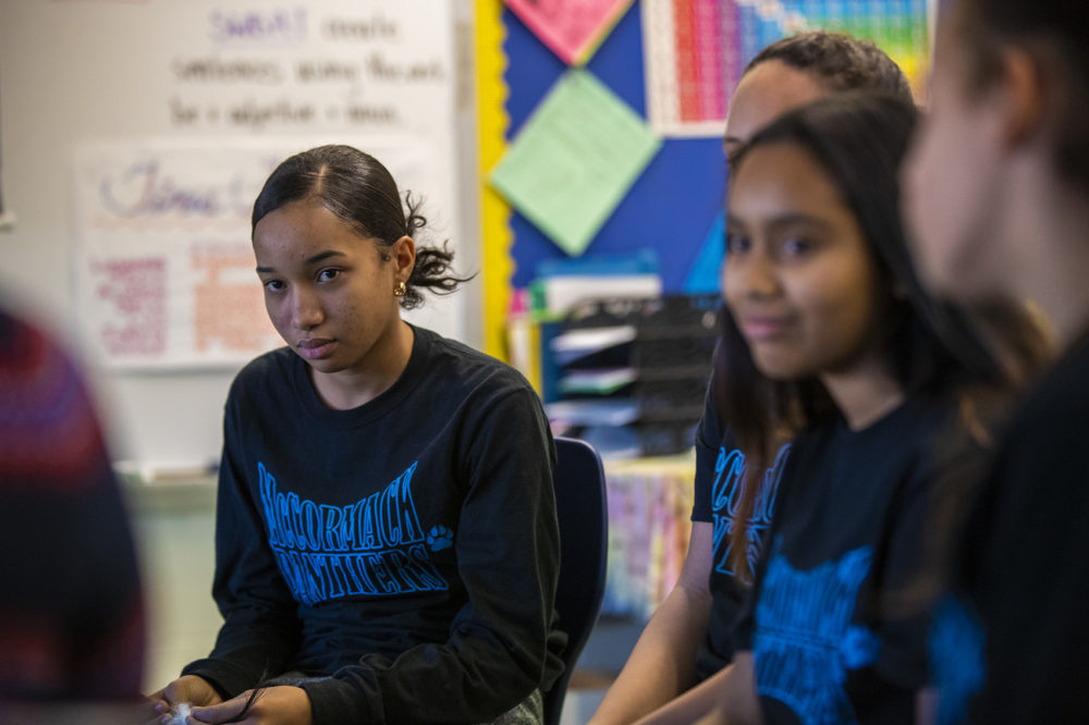 Eighth grader Bianka Bautista and other students discuss the planned closure of the McCormack Middle School during a circle in one of their classrooms.  (Jesse Costa/WBUR)