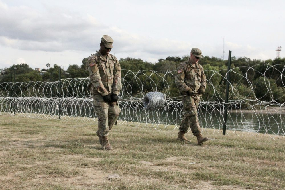 Soldiers from the Kentucky-based 19th Engineer Battalion work in a public park in Laredo, Texas, where they are installing barbed and concertina wire on Nov. 17, 2018. The soldiers are some of the thousands of U.S. troops deployed to the U.S.-Mexico border as part of a mission ordered by President Trump to toughen the frontier and provide engineering and logistical support to Customs and Border Protection agents. (Thomas Watkins/AFP/Getty Images)