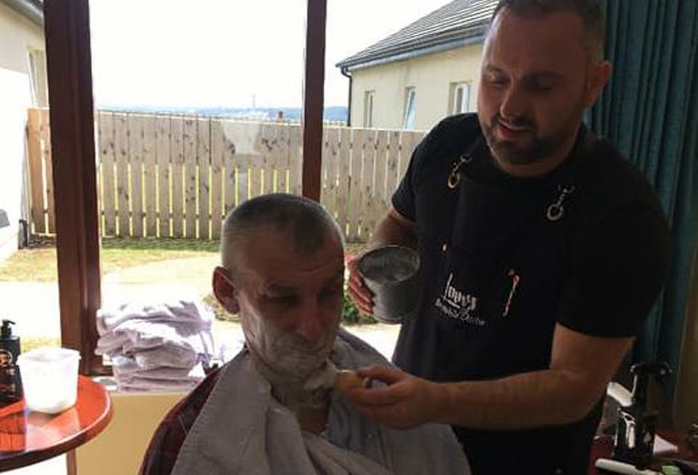 Lenny White gives a client a shave. (Courtesy via Facebook)