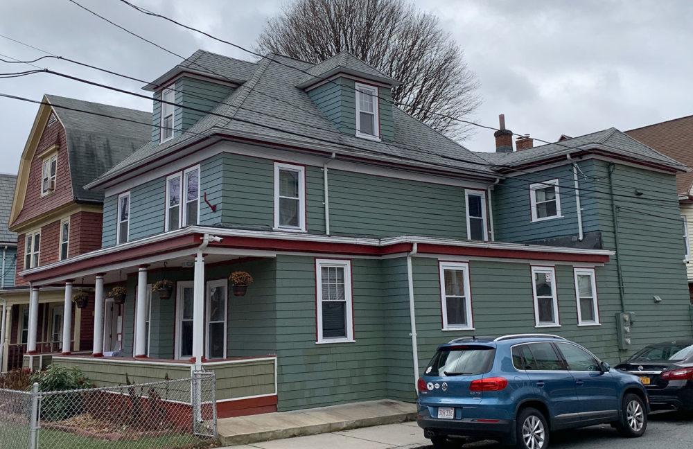 """Liberty House,"" a two-story home run by a Boston nonprofit that allows young residents who previously struggled with homelessness to live independently. (Simón Rios/WBUR)"