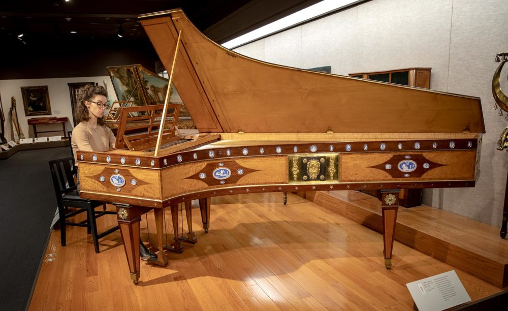 Musician Martina Wlodarczyk plays a harpsichord at the MFA. The instrument was made in France, probably in 1736. (Robin Lubbock/WBUR)