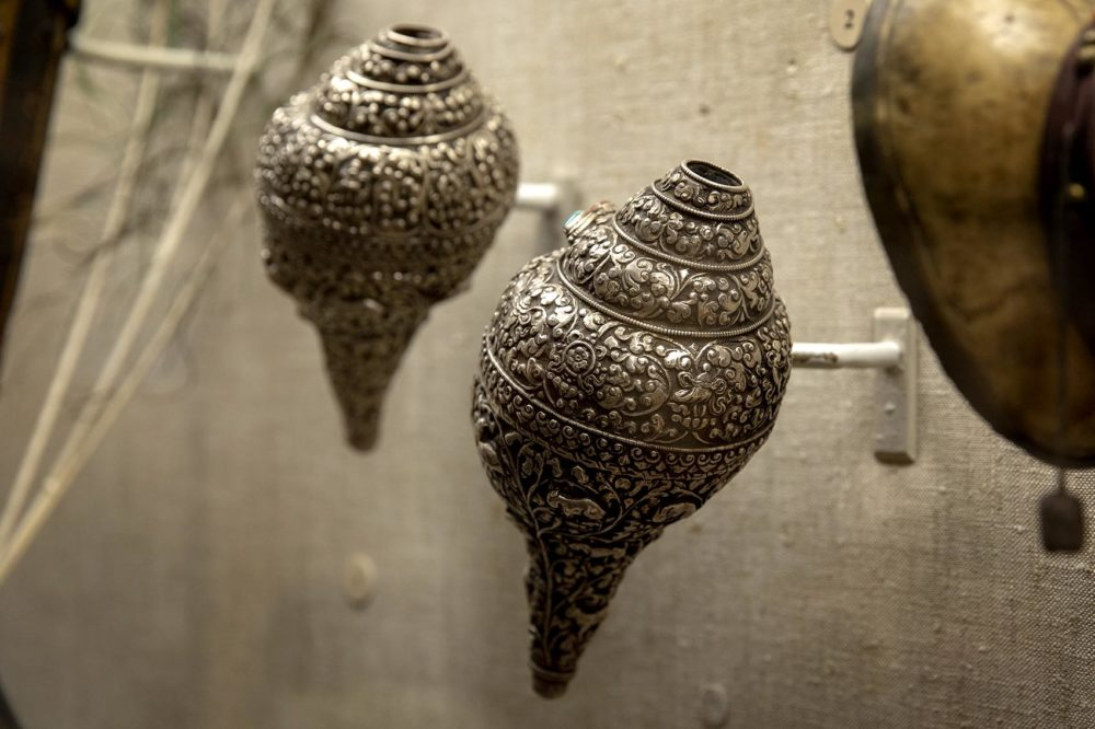 Silver seashell trumpets, probably made in Tibet in the late 19th century. (Robin Lubbock/WBUR)