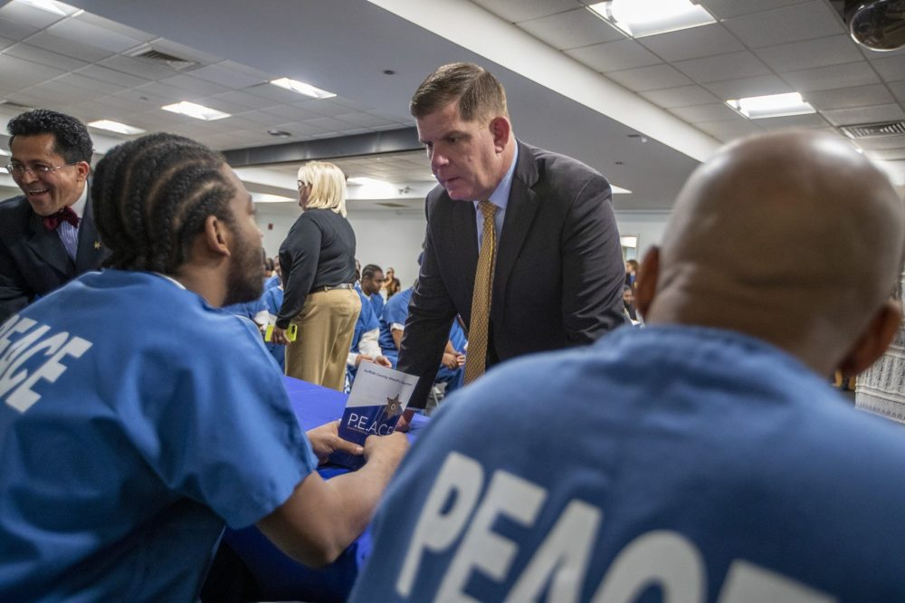 Boston Mayor Marty Walsh chats with some of the inmates at a press conference about the Suffolk County Sheriff's Department's PEACE unit. (Jesse Costa/WBUR)