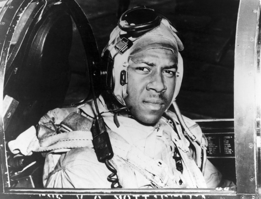 This circa 1950 photo released by the U.S. Navy shows Jesse Brown in the cockpit of an F4U-4 Corsair fighter at an unidentified location. Brown, the first African-American naval aviator, died when he crashed behind enemy lines during the Korean War. Fellow aviator Thomas Hudner crash-landed his own plane in a futile attempt to save Brown. (U.S Navy via AP)