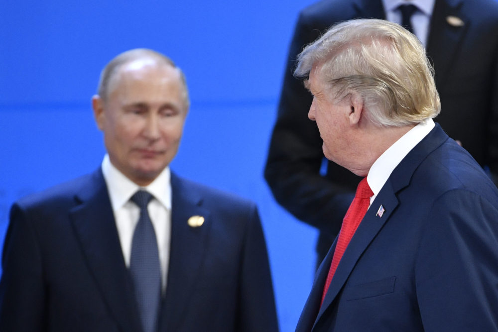 President Trump looks at Russia's President Vladimir Putin as they take their places for a photo during the G-20 summit in Buenos Aires, on Nov. 30, 2018. (Alexander Nemenov/AFP/Getty Images)