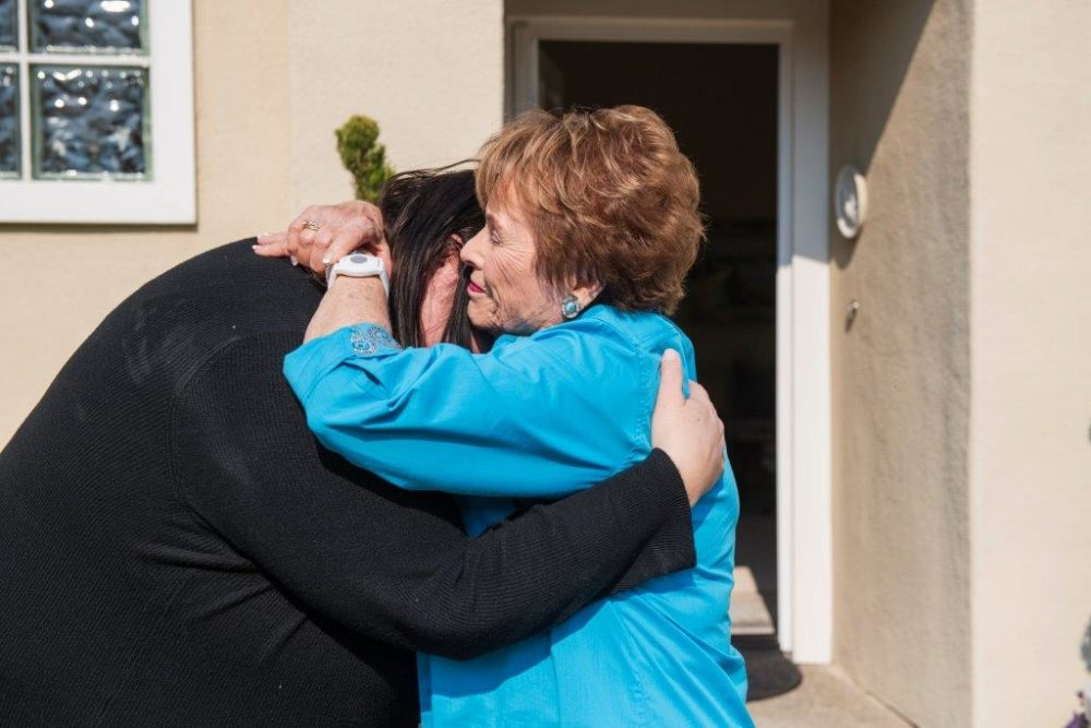 Jenn Carson reunites with her former teacher, Sylvia Case Peterson, after 35 years. (Andrew Cullen for WBUR)