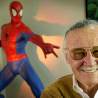 "Stan Lee, 79, creator of comic-book franchises such as ""Spider-Man,"" ""The Incredible Hulk"" and ""X-Men,"" smiles during a photo session April 16, 2002, in his office in Santa Monica, Calif. (AP Photo/Reed Saxon)"