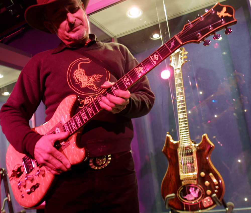 Guitar-maker Doug Irwin strums Wolf, an electric guitar he custom-made for the late Jerry Garcia, at Studio 54 in 2002 in New York. (Tina Fineberg/AP)