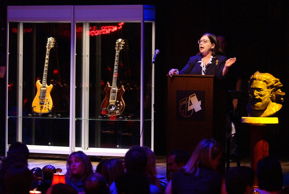 Guernsey's auctioneer Joanne Grant conducts bidding on guitars previously owned by the late Jerry Garcia during an auction on May, 8, 2002, at Studio 54 in New York. The guitar named Wolf, left, sold for $700,000 and Tiger sold for $850,000. (Chad Rachman/AP)