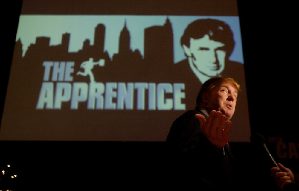 """Donald Trump, seeking contestants for """"The Apprentice"""" television show, is interviewed at Universal Studios Hollywood Friday, July 9, 2004, in the Universal City section of Los Angeles. (Ric Francis/AP)"""