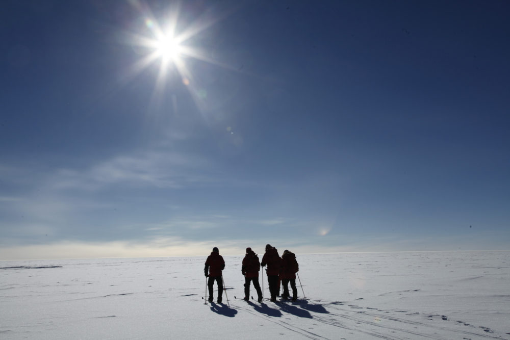 In this Dec. 14, 2011 photo, Norwegian Prime Minister Jens Stoltenbergjoins three polar adventurers heading to the South Pole to mark the 100th anniversary of when explorer Roald Amundsen won the race to the bottom of the globe. Several expeditions skied across Antarctica toattend the ceremony though many were delayed and had to be flown the last stretch. (Jens Stoltenberg/AP)
