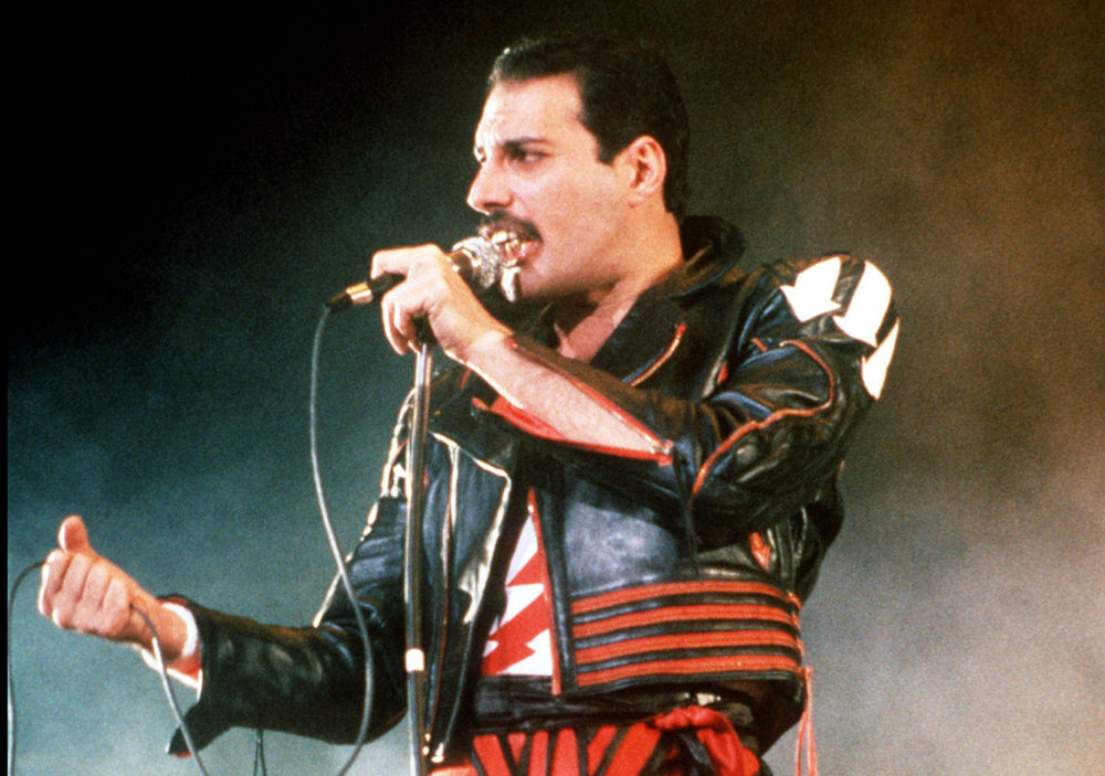 """FILE - In this 1985 file photo, singer Freddie Mercury of the rock group Queen, performs at a concert in Sydney, Australia. Queen guitarist Brian May says an asteroid in Jupiter's orbit has been named after the band's late frontman Freddie Mercury on what would have been his 70th birthday, it was reported on Monday, Sept. 5, 2016. May says the International Astronomical Union's Minor Planet Centre has designated an asteroid discovered in 1991, the year of Mercury's death, as """"Asteroid 17473 Freddiemercury."""" (AP Photo/Gill Allen, File)"""