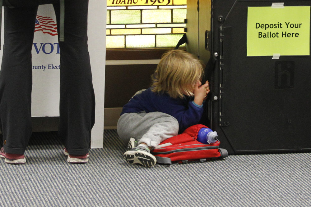 A child waits while their parent votes at Cathedral of the Rockies in Boise, Idaho, on Tuesday, Nov. 8, 2016. (Otto Kitsinger/AP)