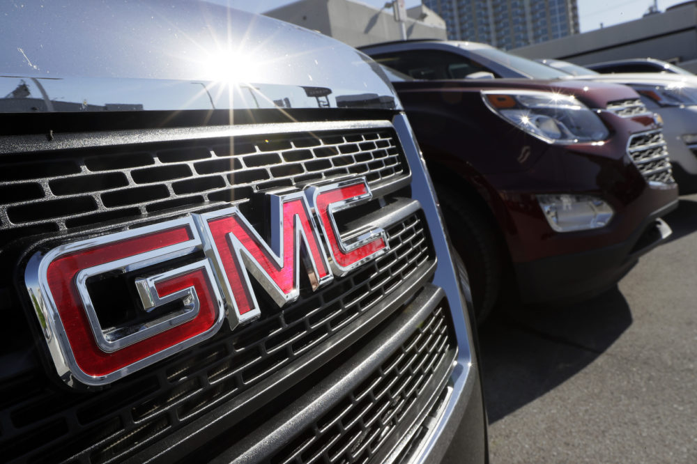 In this April 25, 2017, photo, a GMC truck sits in a General Motors dealer's lot in Nashville, Tenn. (AP Photo/Mark Humphrey)