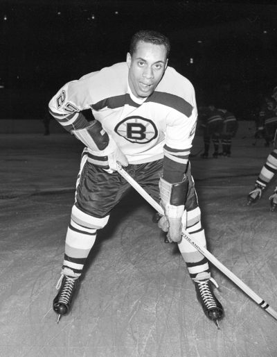 In this Nov. 23, 1960, file photo, 25-year-old left wing Willie O'Ree, the first black player of the National Hockey League, poses for a photo as he warms up in his Boston Bruins uniform prior to an NHL hockey game with the New York Rangers at New York's Madison Square Garden. O'Ree was selected to the Hockey Hall of Fame, Tuesday, June 26, 2018. (AP Photo, File)