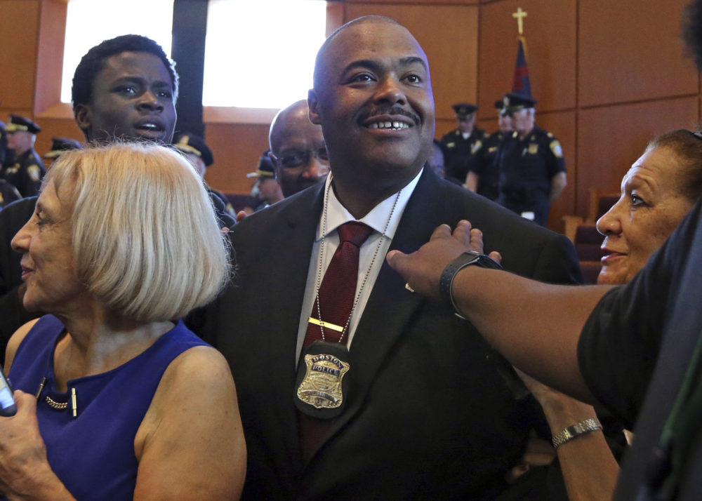 William Gross is surrounded by well-wishers after he was sworn in as Boston's first black police commissioner during ceremonies, Monday, Aug. 6, 2018, in Boston. (Elise Amendola/AP)