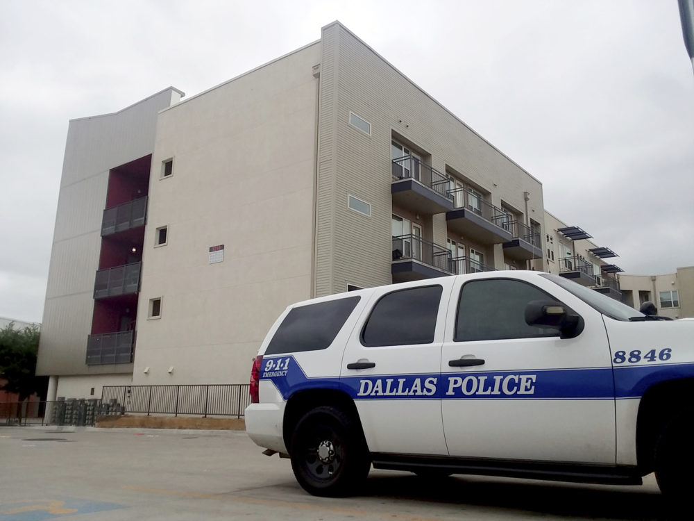 "A Dallas Police vehicle is parked near the South Side Flats apartments on Monday, Sept. 10 2018 photo in Dallas. Authorities say a Dallas police officer said she shot a neighbor whose home she mistakenly entered last week after he ignored her ""verbal commands."" David Armstrong of the Texas Rangers wrote in an arrest affidavit released Monday that Officer Amber Guyger said she didn't realize she was in the wrong apartment until after she shot 26-year-old Botham Jean and went into the hallway to check the address. Guyger was booked Sunday on a manslaughter charge in Thursday night's killing of Jean and was released on bond. (Ryan Tarinelli/AP)"