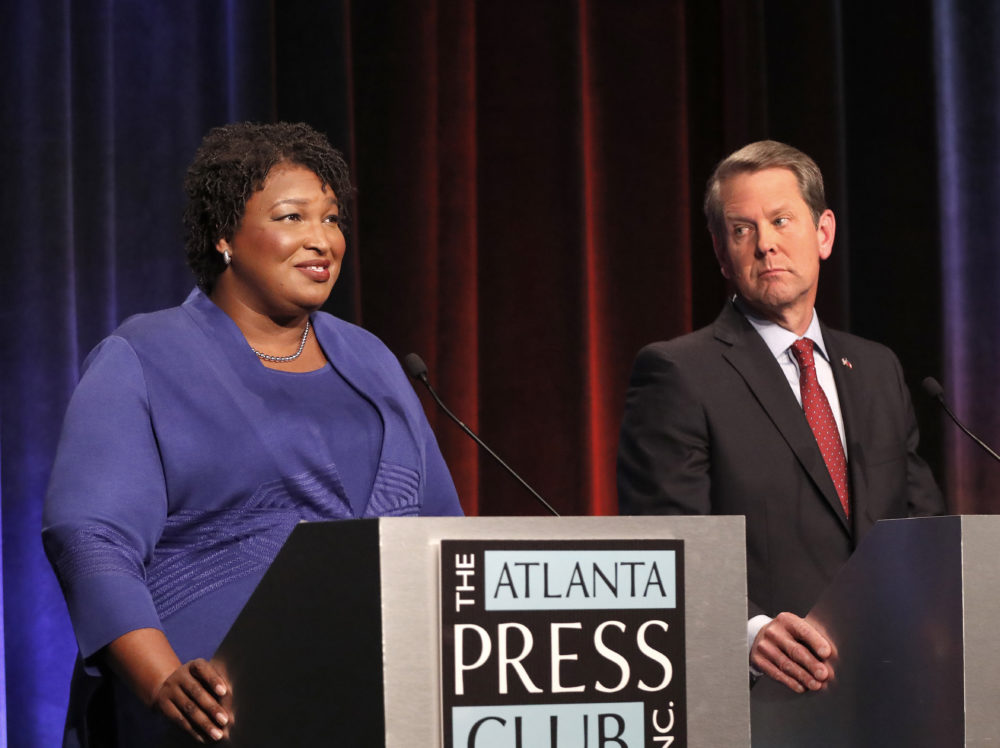 Democratic candidate for Georgia Governor Stacey Abrams, left, speaks as her Republican opponent Sec. State Brian Kemp looks on during a debate Tuesday, Oct. 23, 2018, in Atlanta. (John Bazemore/AP)