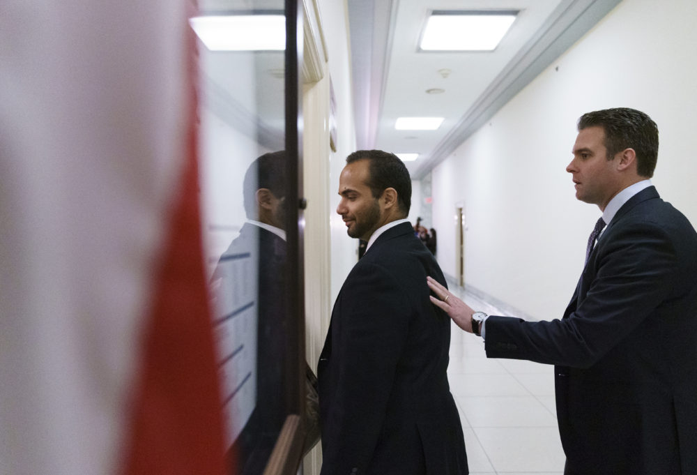 George Papadopoulos, left, the former Trump campaign adviser who triggered the Russia investigation, is guided as he arrives for his first appearance before congressional investigators on Capitol Hill in Washington, Thursday, Oct. 25, 2018. (Carolyn Kaster/AP)