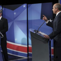 Democratic challenger Jay Gonzalez, right, makes a point during a debate with Republican Gov. Charles Baker Thursday in Needham. (Jim Davis/The Boston Globe via AP, Pool)