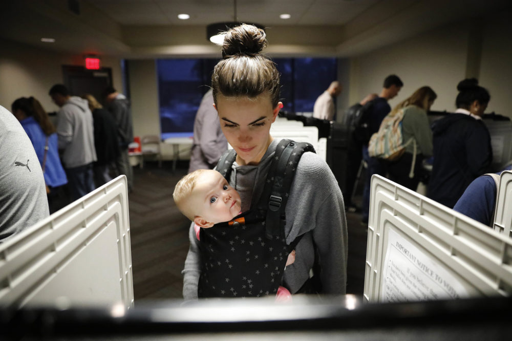 Kristen Leach votes with her six-month-old daughter, Nora, on election day in Atlanta, Tuesday, Nov. 6, 2018. (David Goldman/AP)